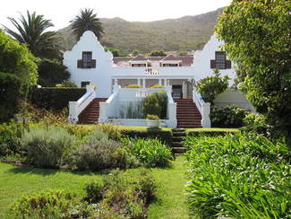 R9500000 The Pearl of St James. - Cape Dutch home with sea and mountain views.